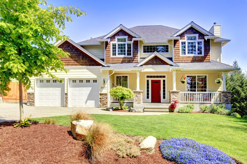 large american beautiful house with red door and beautiful windows